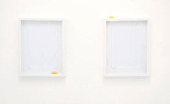 The more literal-minded opted for works that made direct reference to an egg: Jean-Philippe Dordolo's Landscape Drawings (Sunset / Sunrise) (2011), in which two raw egg yolks quiver in the bottom-right and top-left corners of two framed boxes, was prominently displayed in the reception area beneath the orange glow of Dexter Sinister's Neon for the Serving Library (2011).