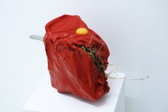 Lebenszyklus eines Huhns, 2011_ Pan Steel Handle, Styrene, Hay, Raw Egg Yolk (changed daily)